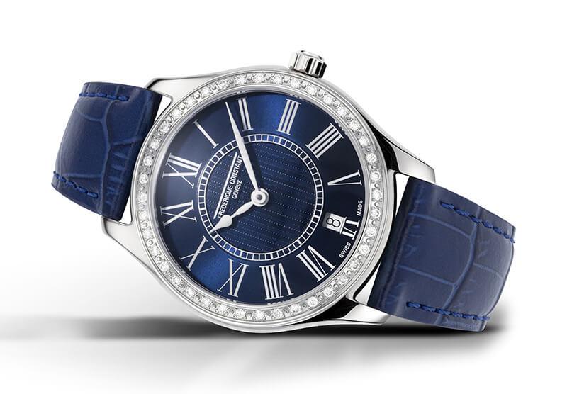 Cadran bleu marine et lunette sertie de diamants, bracelet en cuir